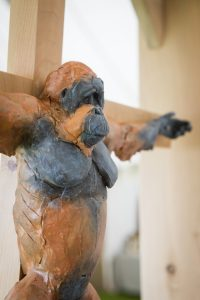 Orangutan on a crucifix