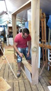 Brother Ben making display frame